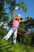 Little girl with hula hoop — Stock Photo