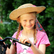 Stock Photo: Girl on a bicycle
