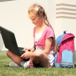 Schoolgirl using computer — Stock Photo