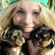 Young girl with cute puppies — Stock Photo