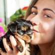 Young girl kiss cute puppy — Stock Photo
