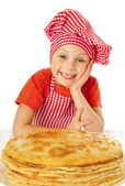 Beautiful little girl with pancakes — Stock Photo