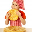 Girl eating tasty pancake — Stock Photo #32642255