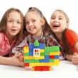 Children playing a toy house — Stock Photo
