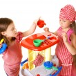 Stock Photo: Happy little girls play cooking