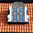 Window of attic on old tiled roof — Stock Photo