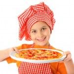 Little girl preparing homemade pizza — Stock Photo #34353397
