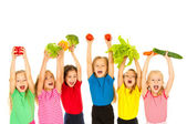 Children with vegetables — Stock Photo