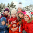Stock Photo: Group of children in winter forest