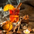 Glass with mulled wine and spices — Stock Photo