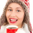 Stock Photo: Young womdrinking hot drink