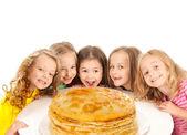 Happy beautiful children with pancakes — Stock Photo