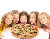 Happy kids with big pizza — Stock Photo