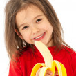 Girl eating banana — Stock Photo