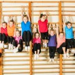 Happy sporty children in gym — Stock Photo #39684401