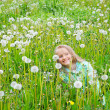 Stock Photo: Little girl in white dandelion