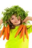 Funny little girl with fresh carrots — Stock Photo