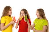 Happy children drinking juice — Stock Photo