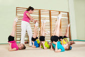 Coach teaching little girls — Stock Photo