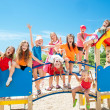 Happy kids playing on playground — Stock Photo #47312873