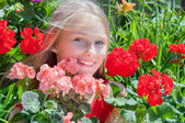 Beautiful young girl with flowers — Stock Photo