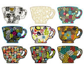 Collection of tea cups with different patterns. — Stock Vector