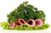 Slices of ham with parsley and salad leaf isolated on white bac — Stock Photo
