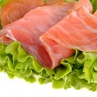 Stock Photo: Sliced salmon fish on green salad
