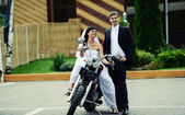Wedding couple sitting on a motorcycle — Stock Photo