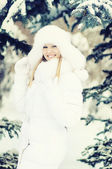Winter portrait of beautiful smiling woman with snowflakes in wh — Stock Photo