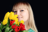 Beautiful attractive woman with colorful bouquet of fresh spring — Stock Photo