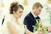 Wedding couple in the Catholic Church — Stock Photo
