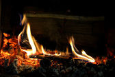Burning wood in fireplace — 图库照片