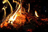 Burning wood in fireplace — Stock Photo