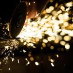 Metal grinding on steel pipe — Stock Photo #46790467