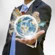 Businessman holding the world in his hand — Stock Photo #12543397