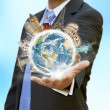 Businessman holding the world in his hand — Stock Photo #12543400