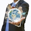 Businessman holding the world in his hand — Stock Photo #12543401