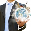 Businessman holding the world in his hand — Stock Photo #12543404