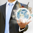 Businessman holding the world in his hand — Stock Photo #12543406