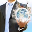 Businessman holding the world in his hand — Stock Photo #12543408