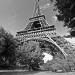 Paris Eiffel Tower in France during sunny day - Stock Photo