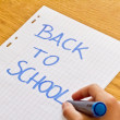 Back to school concept written by a young girl — Stock Photo