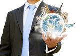Businessman holding the world in his hand — Stock Photo