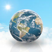 Planet Earth on a cloudy background — Stock Photo