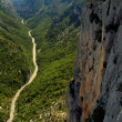 Narrow river gorges of the Canyon of the Verdon river in the Southern Alps, in France. A climber scales the steep cliffs toward the top of the ravine — Stock Photo