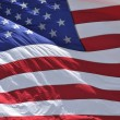 Beautiful, full-frame sunlit waving American flag - great for patriotic backgrounds, slides and presentations — Stock Photo