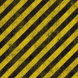 Old grungy yellow hazard stripes on a black metal plate - seamless texture perfect for 3D modeling and rendering — Stock Photo