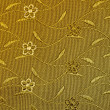 Close-up of a golden floral pattern on a cocktail vest - natural photo texture perfect for 3D modeling and rendering — Stock Photo