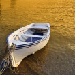 A small row boat beached on the shore at sunset - Cadaques, Spain — Stock Photo